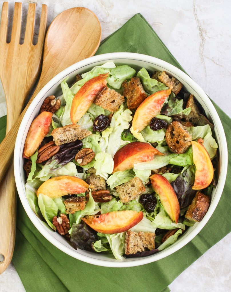 Peach panzanella with homemade croutons, honey mustard dressing, pecans and cherries.